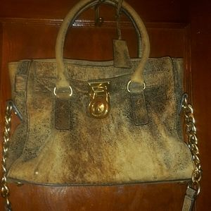 Michael Kors mocha brown leather satchel.